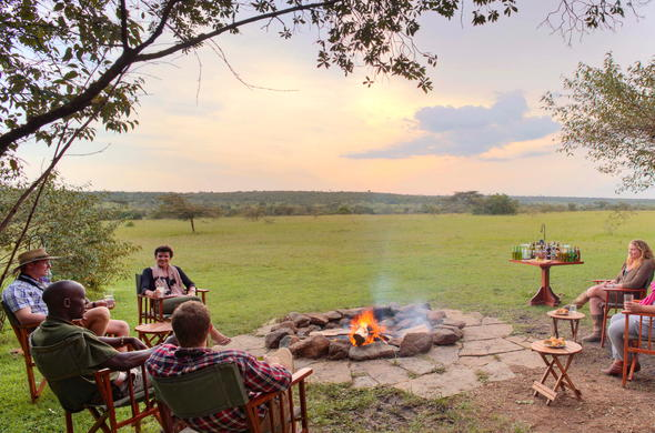 Enjoy the camp fire at Encounter Mara after an exciting day in the bush.
