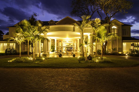 Hemingways Nairobi exterior at night.