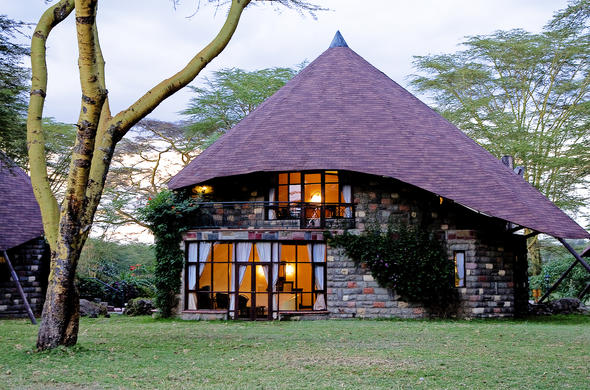 The comfortable cottages located on the lush green lawns at Lake Naivasha Sopa Resort.