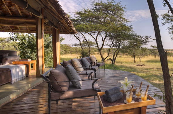 Enjoy a drink on the private deck of Naboisho Camp.
