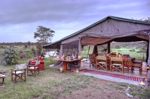 Watch the sun set around a campfire at Ol Pejeta Bush Camp.