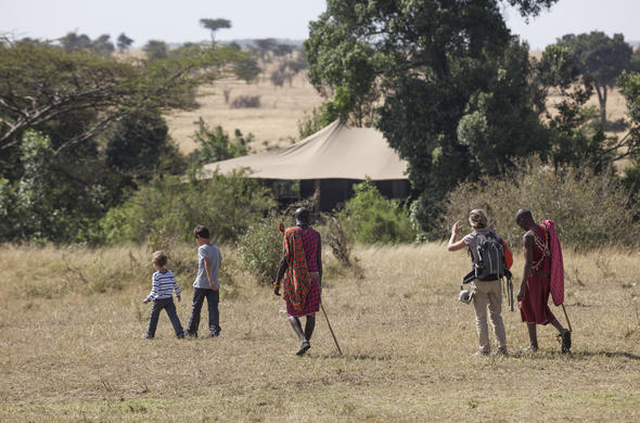 Explore on a safari walk at Porini Lion Camp.